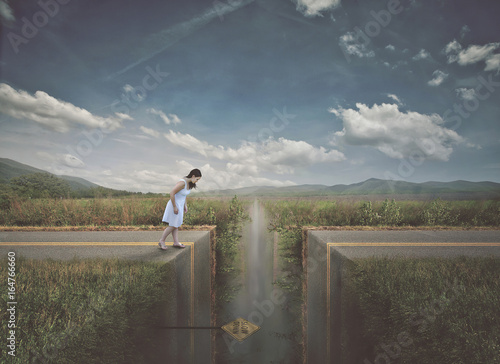 Woman approaching broken road