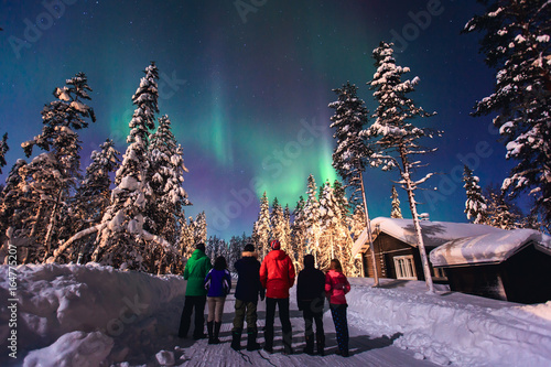 Fotobehang Antarctica Beautiful picture of massive multicoloured green vibrant Aurora Borealis, Aurora Polaris, also know as Northern Lights in the night sky over winter Lapland, Norway, Scandinavia
