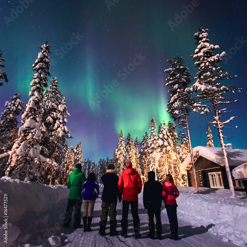Staande foto Antarctica Beautiful picture of massive multicoloured green vibrant Aurora Borealis, Aurora Polaris, also know as Northern Lights in the night sky over winter Lapland, Norway, Scandinavia
