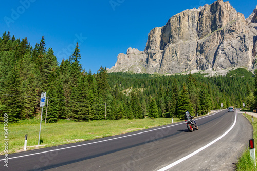 Mountain road with motorbike in Dolomites