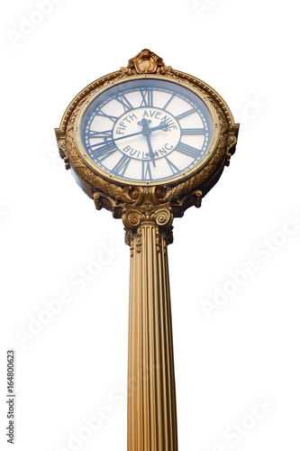 Fifth Avenue building golden clock isolated in New York, clipping path