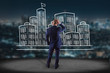 Businessman in front of a wall with Hand drawn city center displayed on a futuristic interface - Travel concept - 164801254