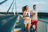 Attractive man and beautiful woman jogging together - 164801241