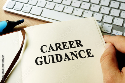 Hands holding book with title career guidance.