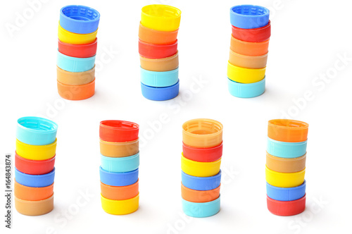 pile of colorful plastic bottle cap on white background