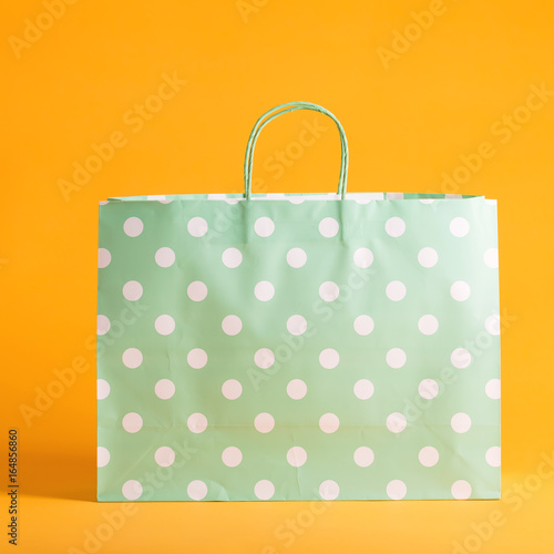 Polka dot gift bag on a vibrant background
