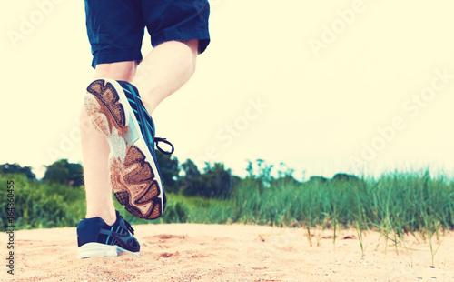 Runner going for a jog at the beach