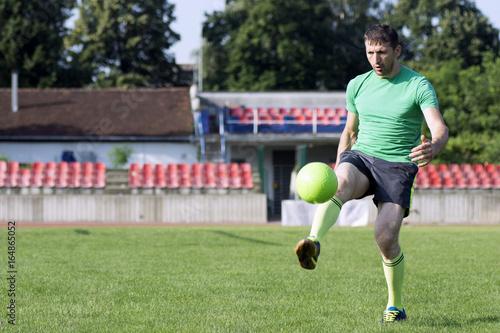 shooting football ball