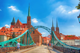 WROCLAW, POLAND - JULY 18, 2017: Wroclaw Old Town. Cathedral Island (Ostrow Tumski) is the oldest part of the city. Odra River, boats and historic buildings on a summer day. - 164866642