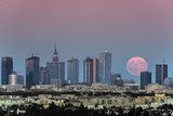 Rising moon over Warsaw city, Poland