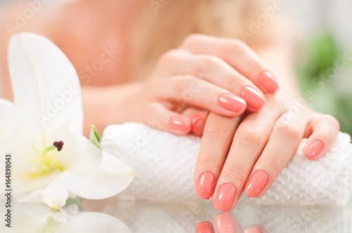 Leinwanddruck Bild Manicure concept. Beautiful woman's hands with perfect manicure at  beauty salon.