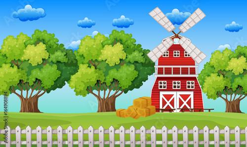 Fotobehang Boerderij Farm scene with windmill in the field