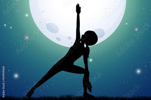 Silhouette woman doing yoga