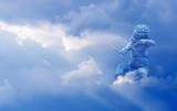 Cupid with arrow over cloudy sky - 164947641