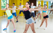 Men and women are learning zumba movements