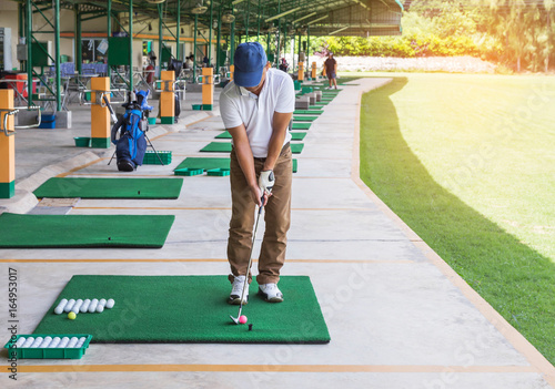 Poster golfer during practice driving range in golf course yard signs