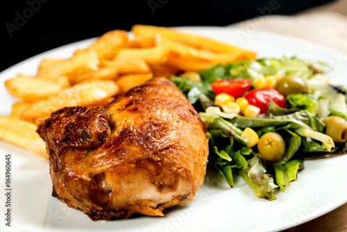 Fresh chicken steak with tomatoes and french fries - 164960645