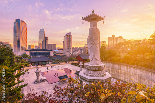 Sunset at Bongeunsa temple of downtown skyline in Seoul City, South Korea Poster