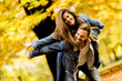 Quadro Young loving couple having fun in the autumn park