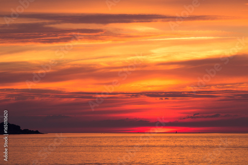 Poster Koraal beautiful sunset sky over the baltic sea