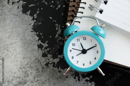 Turquoise alarm clock on black