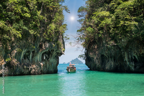 Fotobehang Thailand Beautiful landscape of rocks mountain and crystal clear sea with longtail boat at Phuket, Thailand. Summer, Travel, Vacation, Holiday concept.