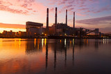 Electric Power plant at sunrise. New York city infrastructure on the shore of East River at dawn.