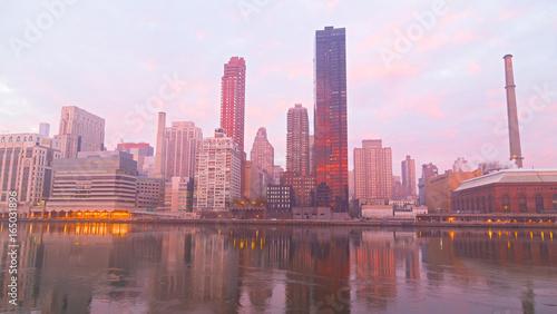 Manhattan skyline on a foggy morning, New York, USA. New York downtown near East River at dawn.