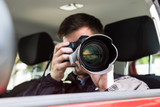Private Detective Photographing With Slr Camera - 165046210