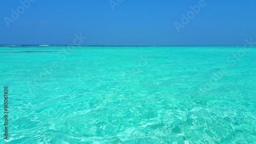 Foto op Canvas Groene koraal P00589 Maldives beautiful white sandy beach background on sunny tropical paradise island with aqua blue sky sea water ocean 4k