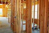 A stick built house under construction - 165138008