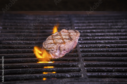 Tasty beef steak on the grill