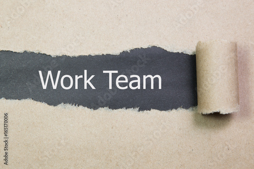 The text Work team appearing behind torn paper Poster