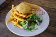 A plate of traditional beer-battered fish and chips in England - 165175415