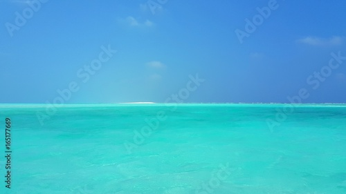 P00506 Maldives beautiful white sandy beach background on sunny tropical paradise island with aqua blue sky sea water ocean 4k