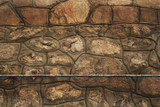 Pattern of the ancient style stone wall with cement.