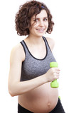 Young pregnant woman practicing fitness