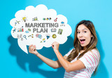 Marketing Plan text with young woman holding a speech bubble on a blue background