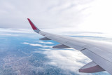 View of airplane wing.Flying high above the blue sky.