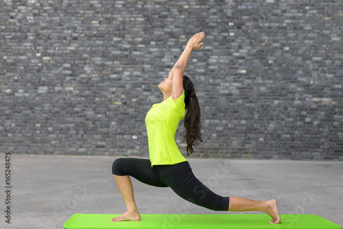 Fit athletic young woman doing yoga exercises