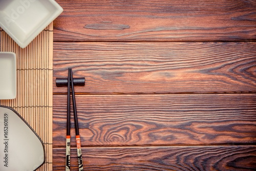 Sushi accessories on a brown wooden background Poster