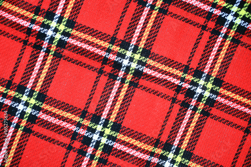 Red Scottish tartan plaid material pattern background