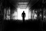 Man in a tunnel in black and white