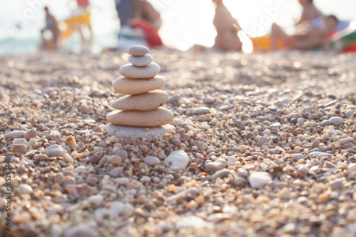 Foto op Plexiglas Stenen in het Zand zen stone on beach for perfect meditation