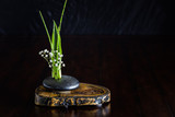 Japanese flower arrangement, simply putting flowers in a container.