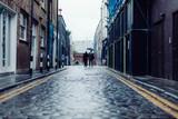 Couple walking down cobble street