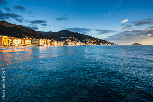 Empty mediterranean sand beach in traditional touristic town Alassio on italian Riviera by San Remo, Liguria, Italy