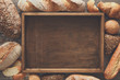 Bread bakery background. Brown and white wheat grain loaves comp - 165313059