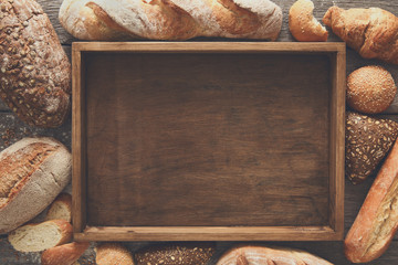 Bread bakery background. Brown and white wheat grain loaves comp