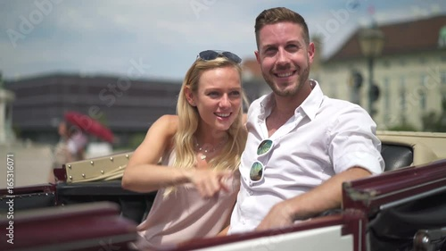 Sticker 4K travel video happy smiling young sightseeing couple in horse drawn carriage in Vienna